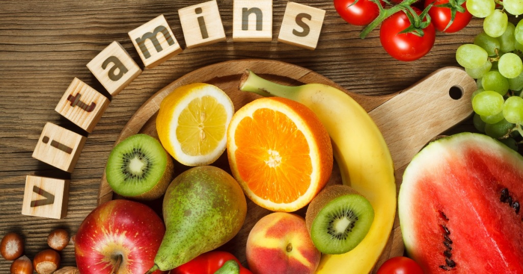 fruits and vegetables..Blcocks forming the the words vitamins