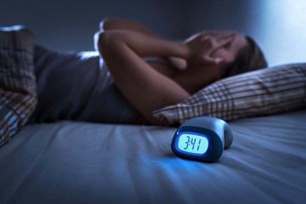 woman can't sleep alarm clock